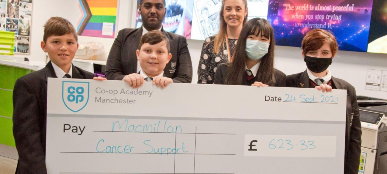 Raising money for Macmillan through our cake sale